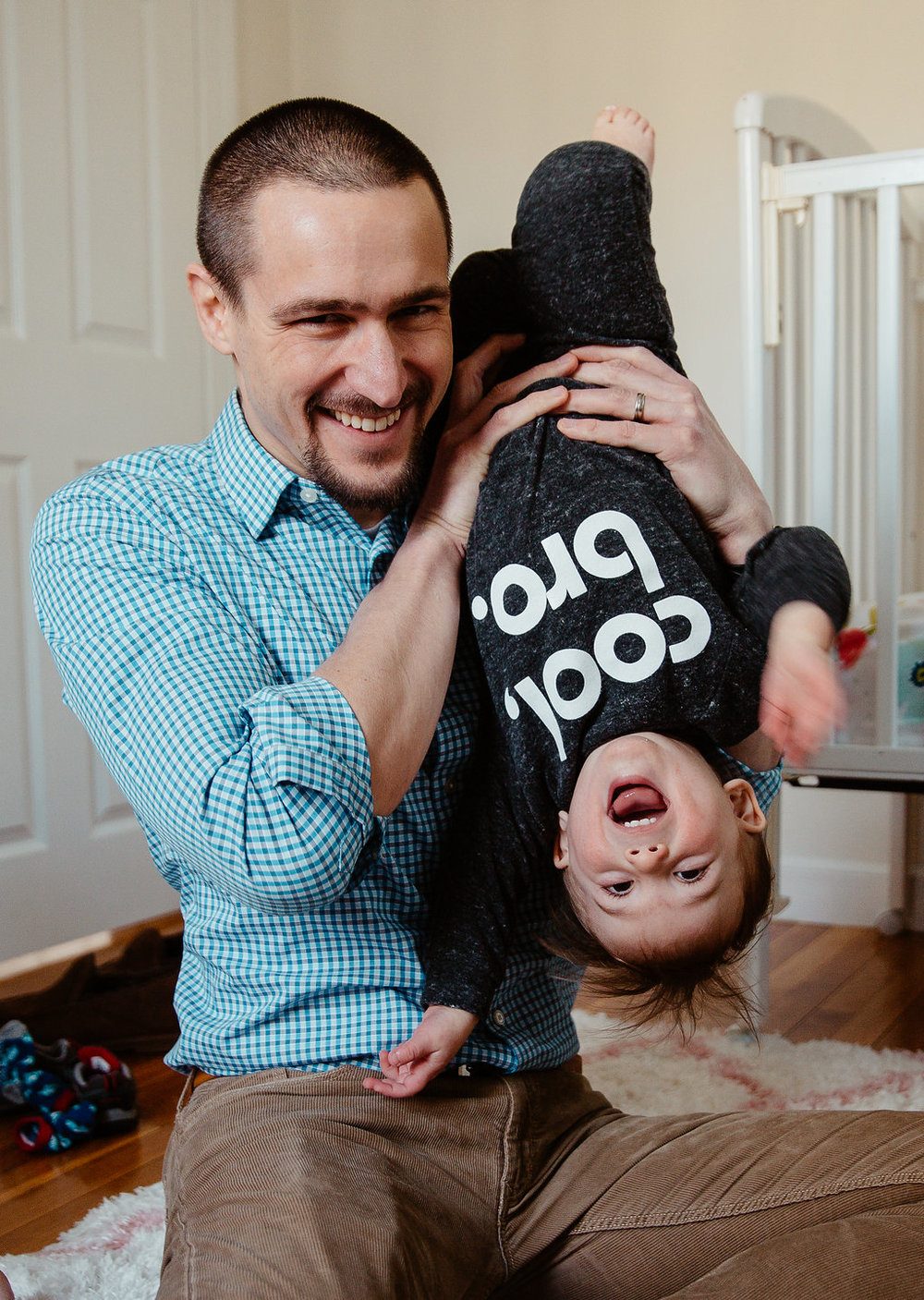Father and toddler son having fun during Sudbury Greater Boston newborn family photo session