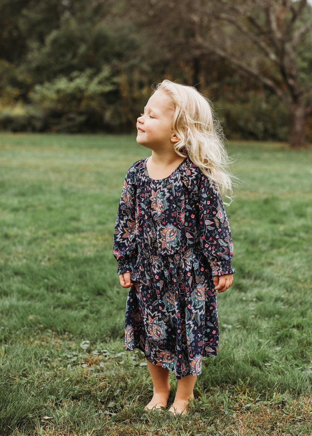Toddler girl in boho dress for Sudbury family portraits. Boston family photographer, natural light, candid.