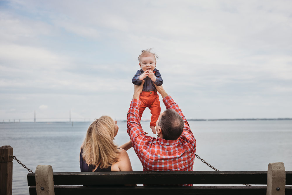 Baby with wild hair! Family beach photos with Boston family photographer Joy LeDuc. Natural light. Candid. Lifestyle.