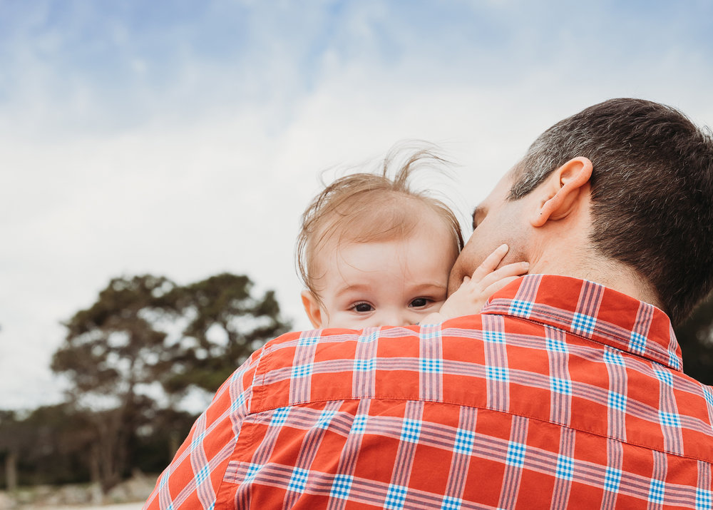 Dad and baby son with wild hair on the beach. Boston family photographer. Baby photos Massachusetts.
