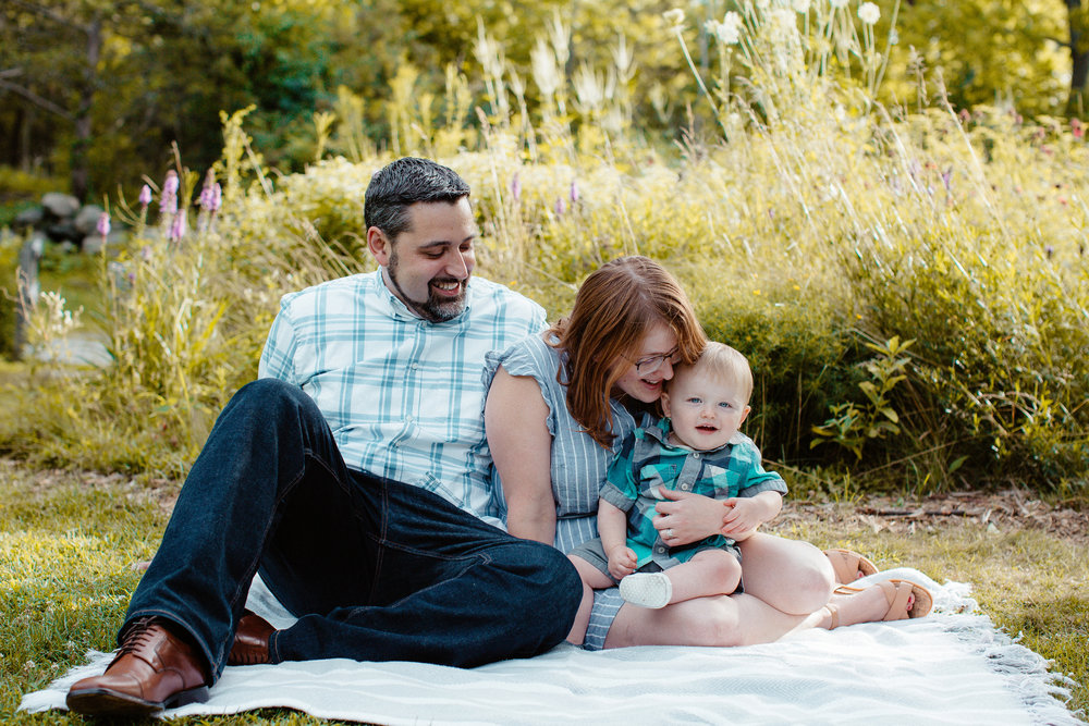 Mom, dad, and baby springtime photos in Acton, Massachusetts. Boston family photographer. Lifestyle photography.