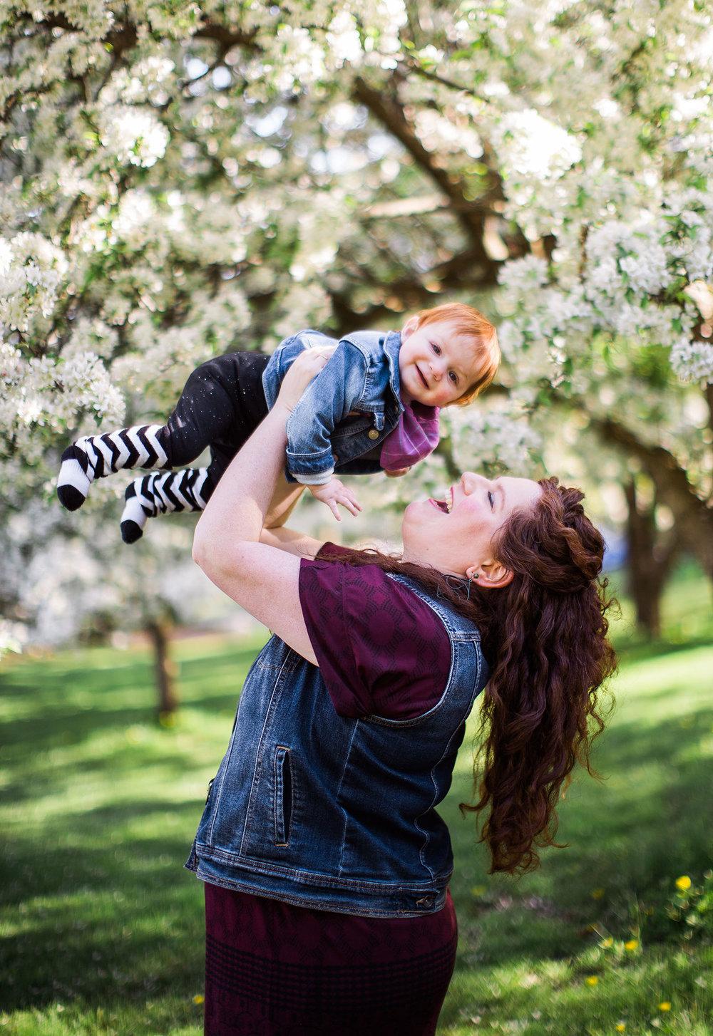 Sweet baby girl in the springtime. Boston family photographer Joy LeDuc. Cherry blossoms, natural light, Acton, Massachusetts.