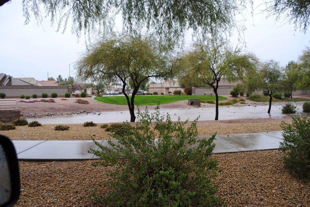 Heavy rains drain through the greenbelts in Phoenix
