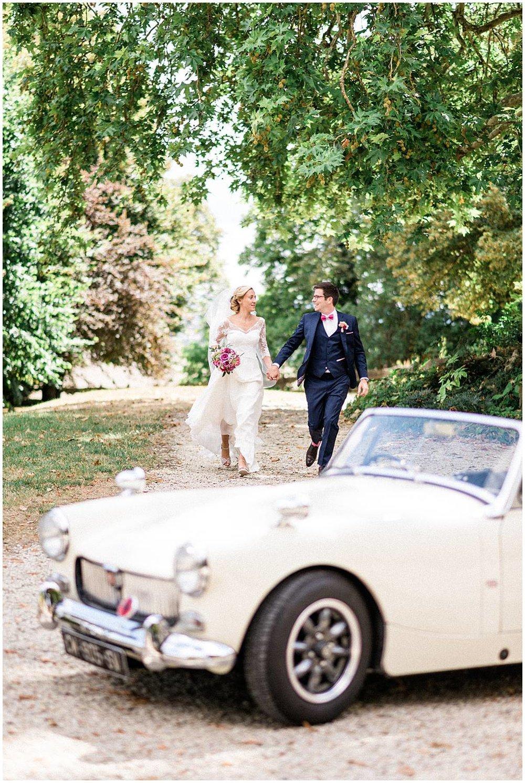 Happy bride and groom running in Reims