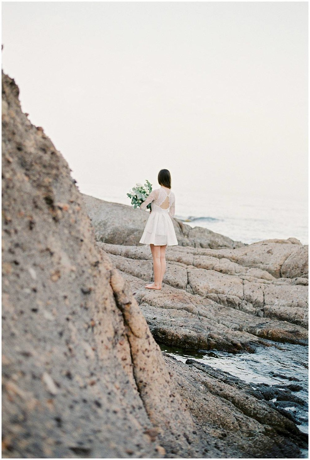 Bride holding a bouquet close to the Mediterranean sea french riviera