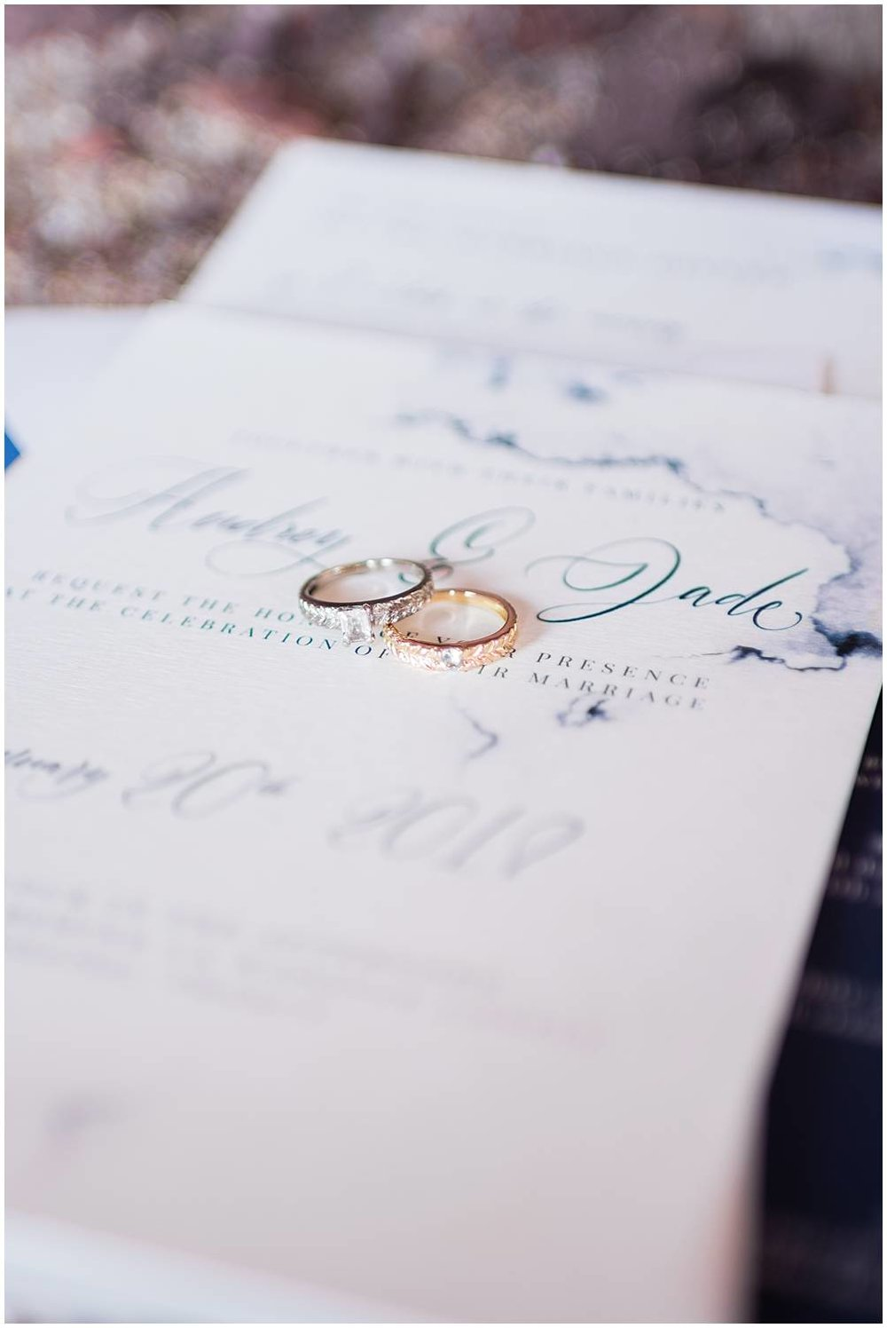 two wedding rings display on a stationery