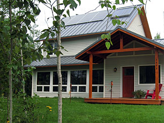 Eco-Home at Hawk Ridge - Eco-Home at Hawk Ridge is a solar model home demonstrating energy efficiency, renewable energy, and green building. This project has been a joint effort between Wagner Zaun Architecture, Women in Construction Company, and Conservation Technologies, with support from several other local agencies and consultants. The home will initially be used for demonstration and educational purposes, and the design and construction methods will serve as an example of how to build Low-Energy, high-performance homes with attention to conservation and health of people and the environment. The overall concept features site-sensitive passive solar design with a high-performance thermal envelope, a grid-tied solar PV array, a solar domestic hot water system, and a solar hybrid heating design.