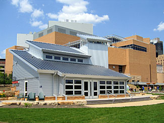 Science House - The Science House at the Minnesota Science Museum was designed as a zero-emissions demonstration facility and is currently used as a Resource Center for Educators. Through careful planning and collaboration, the design team chose to match energy efficient strategies with solar electric technology for developing a project that integrates the sun's energy for providing light, power, and heat. The Science house was equipped for ongoing monitoring of the building's performance, providing educational data for informing future building designs.