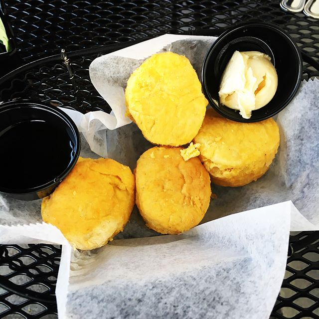 A sampling of the foods that this vegetarian ate while in North Carolina for sock production. Sweet potato biscuits with molasses, tomato pie, hush puppies with herb butter, cornbread with honey ginger butter, and pimento cheese dip with our wine.