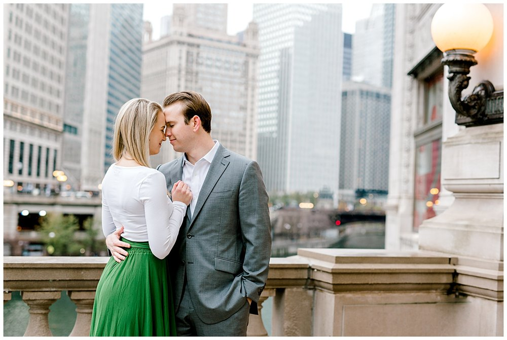 wrigley-building-chicago-illinois-downtown-engagement-session-wedding-photographer-green-dress-winter-holiday-christmas-16
