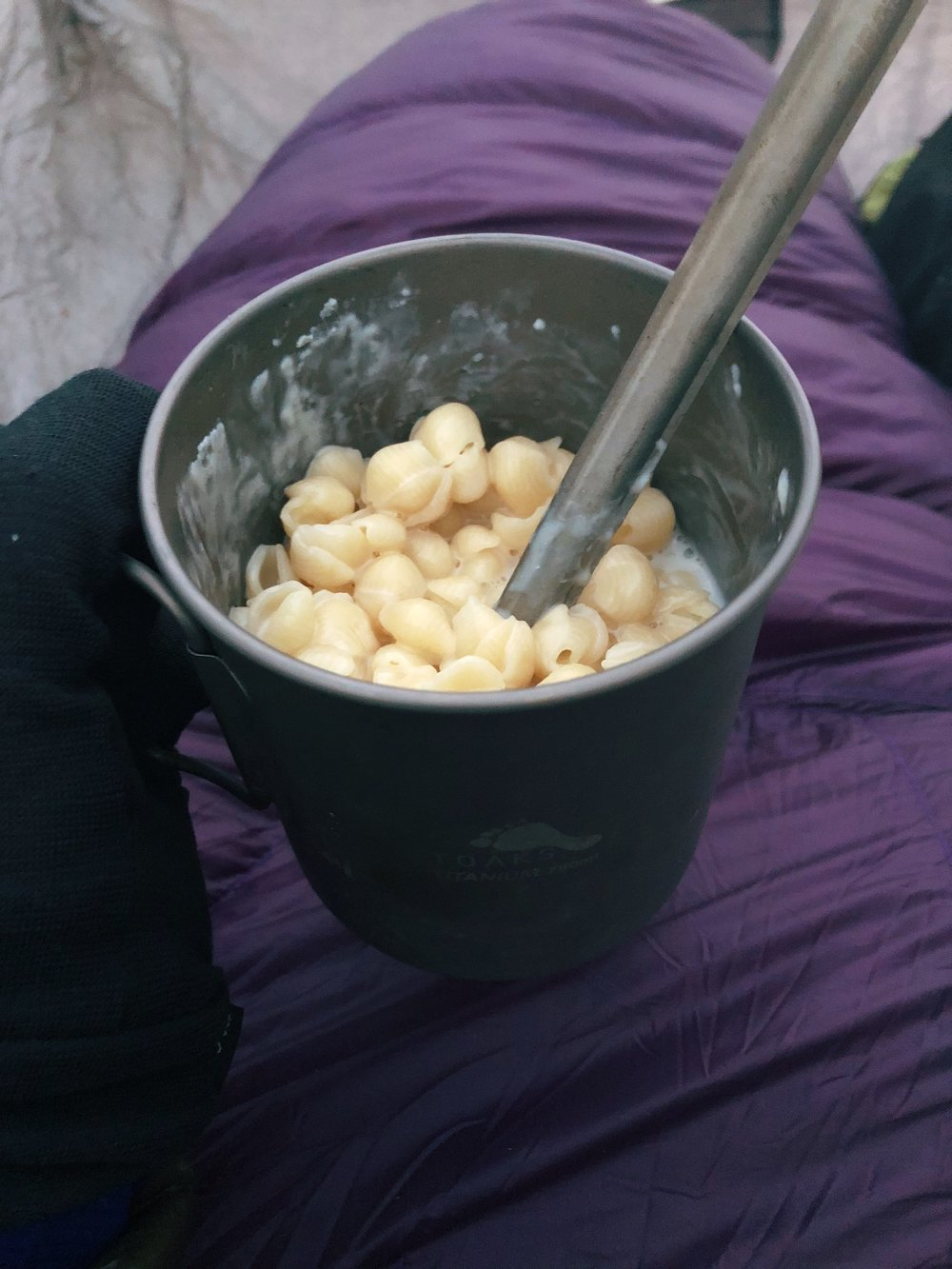 Eating my last meal - Annie's white cheddar Mac - in my quilt in my tent wearing all of my layers