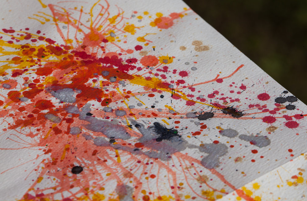 Splatter Paint - I make splatter paint stationary in the winter. I use watercolor, gouache, acrylic and ink, and blast it all with an air compressor.