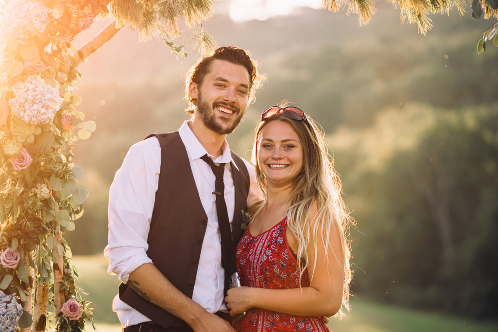 couples portrait with sun flare shining in