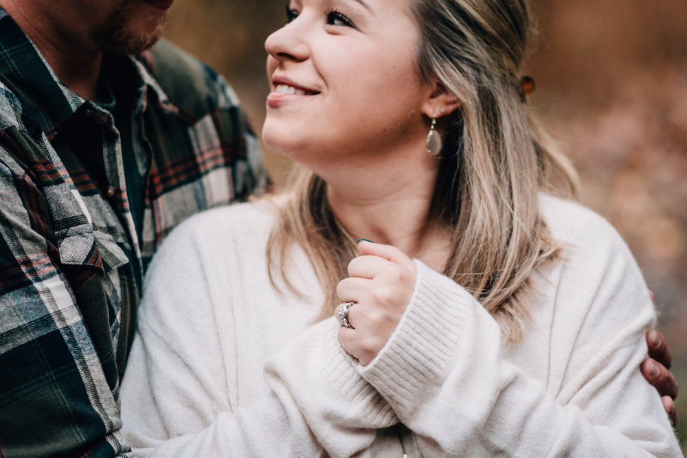 Photo of engagement ring on girl smiling at guy