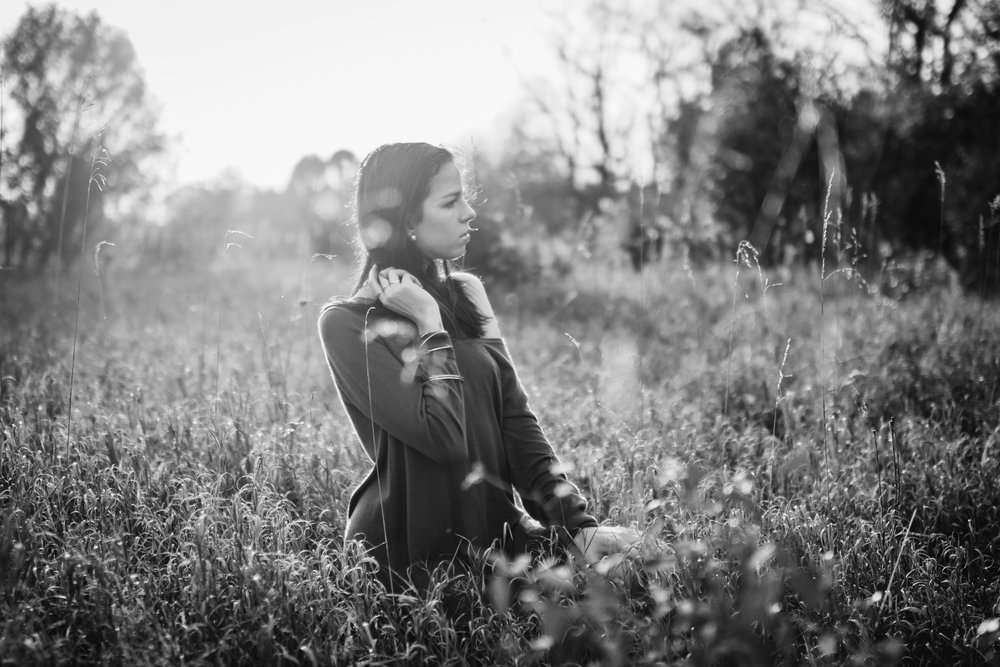 Senior in field with backlight