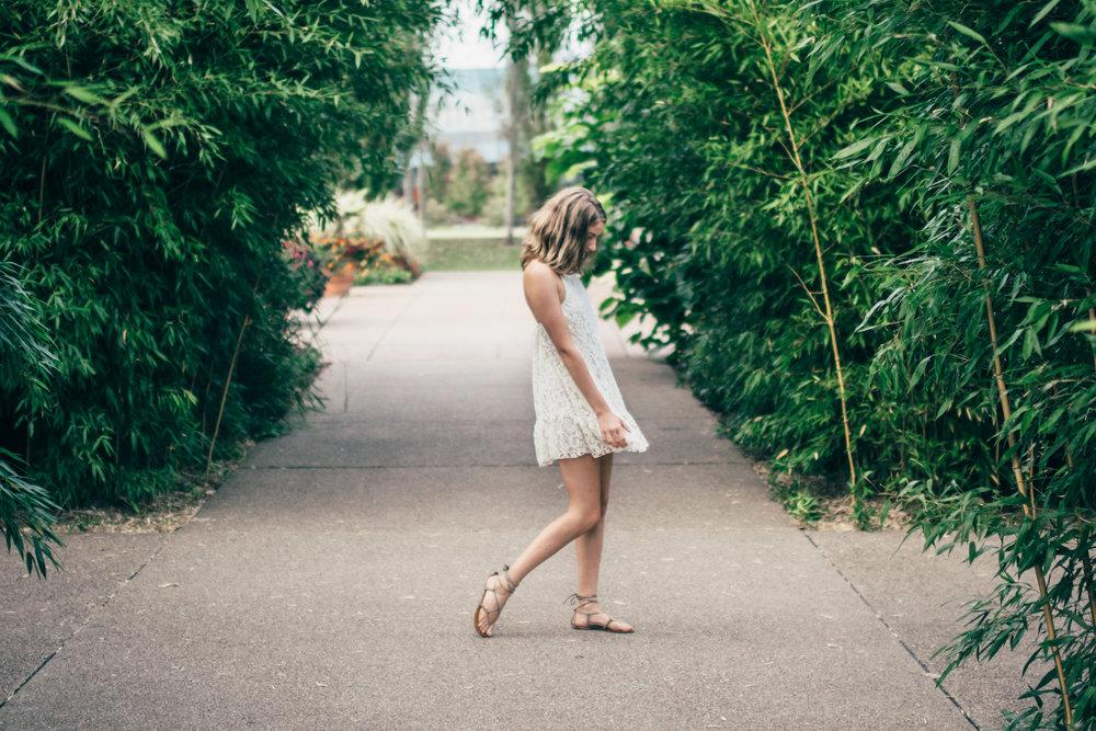 Senior girl walking through bamboo