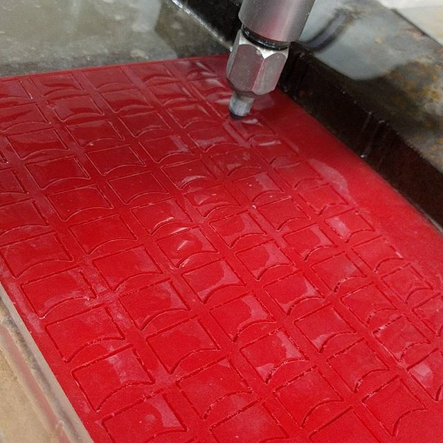 "No parts too small for the #waterjet. These are little 0.25"" thick red rubber ""fingers"" that are about 0.625"" x 0.375"" cut with water only, no abrasive. #waterjetcut #hazletnj #nj"