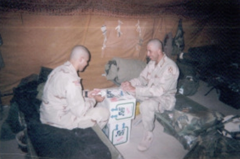 CPL Gonzales and SGT Burdick passing time playing cards (a popular pastime)