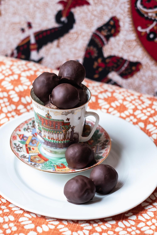 Bite-sized dark chocolate-covered cashew cherry balls