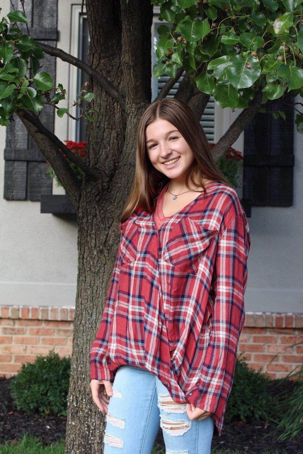 Ainsley Oppmann: Plaid flared Shirt: $