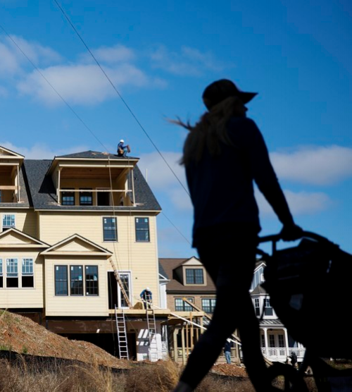 """A stroller passing new townhomes under construction along Atlanta's BeltLine. David Goldman/AP"""