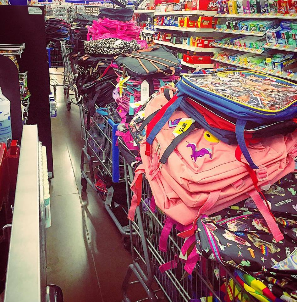 7 carts filled to the top with 500 backpacks for children in Nashville that are living in poverty.