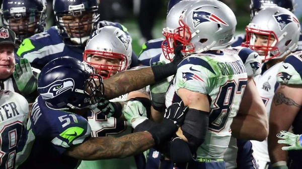 "Bruce Irvin and Rob Gronkowski ""exchange words"" near the end of Super Bowl XLIX."