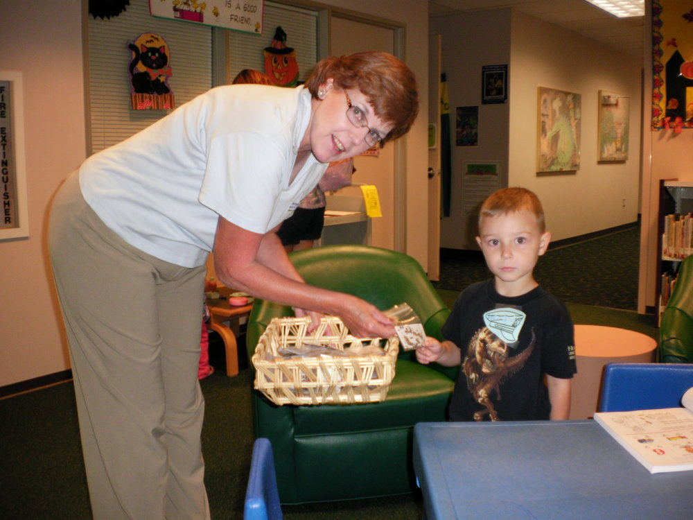 Montgomery County Memorial System librarians helps us pass out seeds to feed Monarch caterpillars