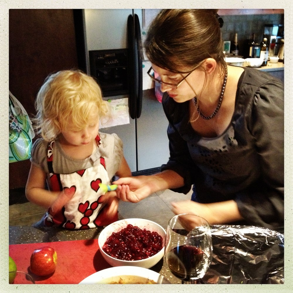 My oldest daughter taste testing the cranberry-pomegranate sauce, Thanksgiving 2012