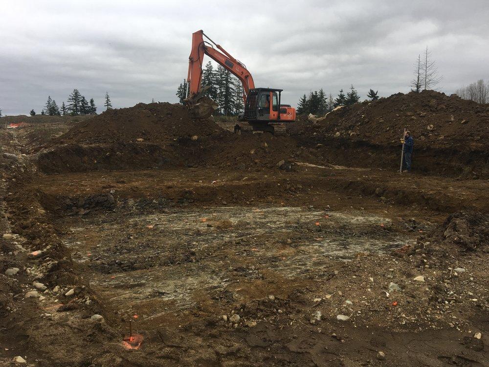 Excavating to undisturbed soil.