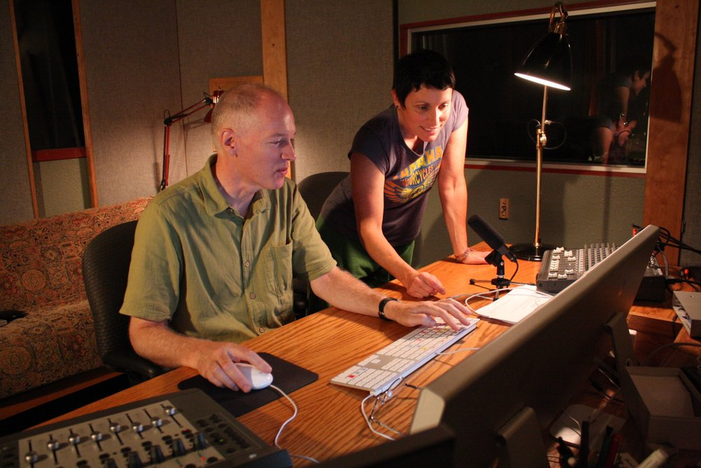 Tom and Susan at the 5th Street location. A window looks into the newly complete larger mix room next door. (2011)