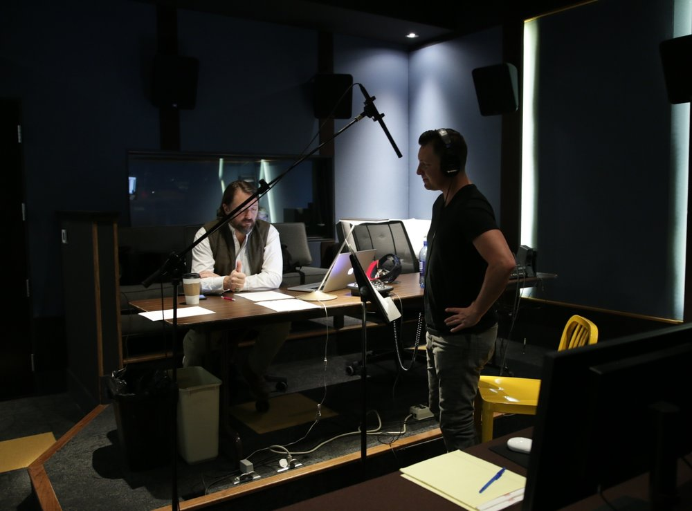 "Director Ty Roberts and lead Lane Garrison recording for ""Iron Orchard."""