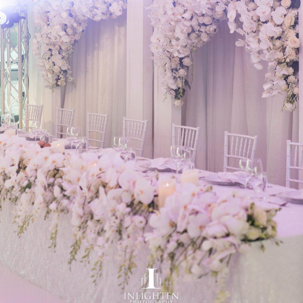 custom_backdrop_sydney_opera_house_wedding_white_frames_white_phaleanopsis_orchids_haning_bridal_table_chandeliers.jpg