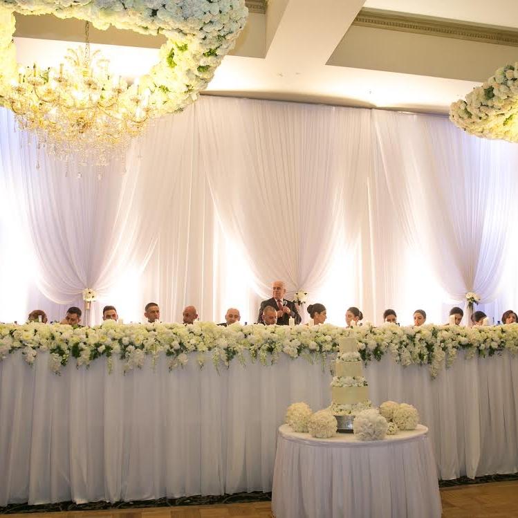 wedding_backdrop_Westella_renaissances_bridal_table_crystal_chandeliers.jpg