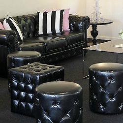 black_chesterfiel_lounge_and_ottomans_sydeny_furniture_hire_events.png