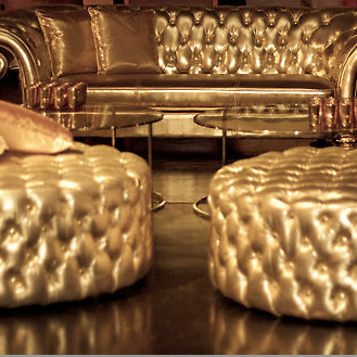Front_photo_gold_chesterfield_lounge_ottomans.png