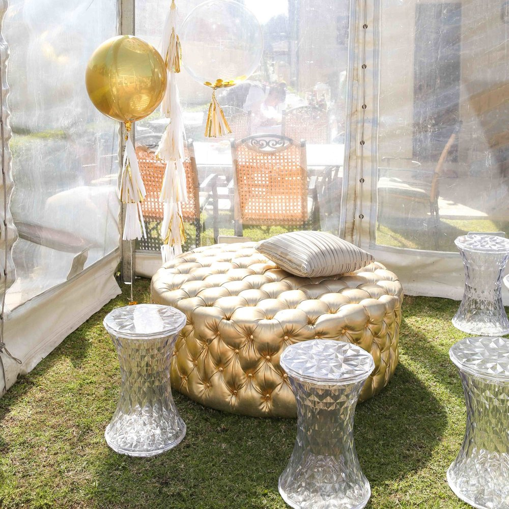 gold_chesterfield_lounge_ottomans_clear_geometric_perspex_stool.jpg