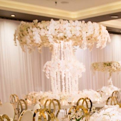 Le Montage - White Paisley luxury linen, custom floral stands, orchid centrepiece stands and tree trunk structure, circular and semi circular tables with cut out centre.JPG
