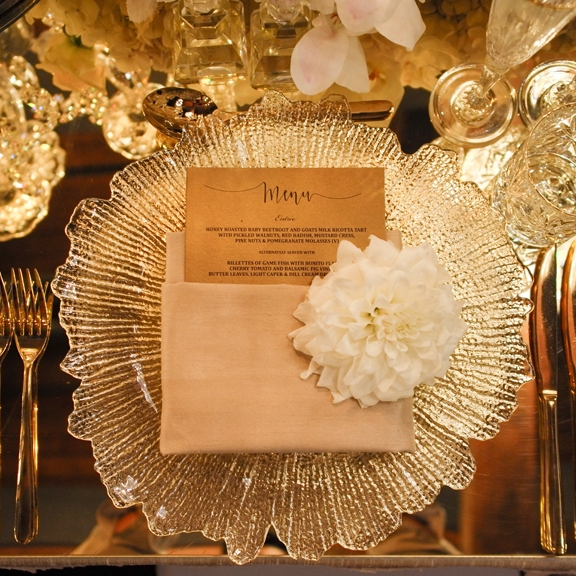 Crystal_cut_charger_plate_champagne_napkin_gold_mirror_table_top_cutlery_glassware.jpg