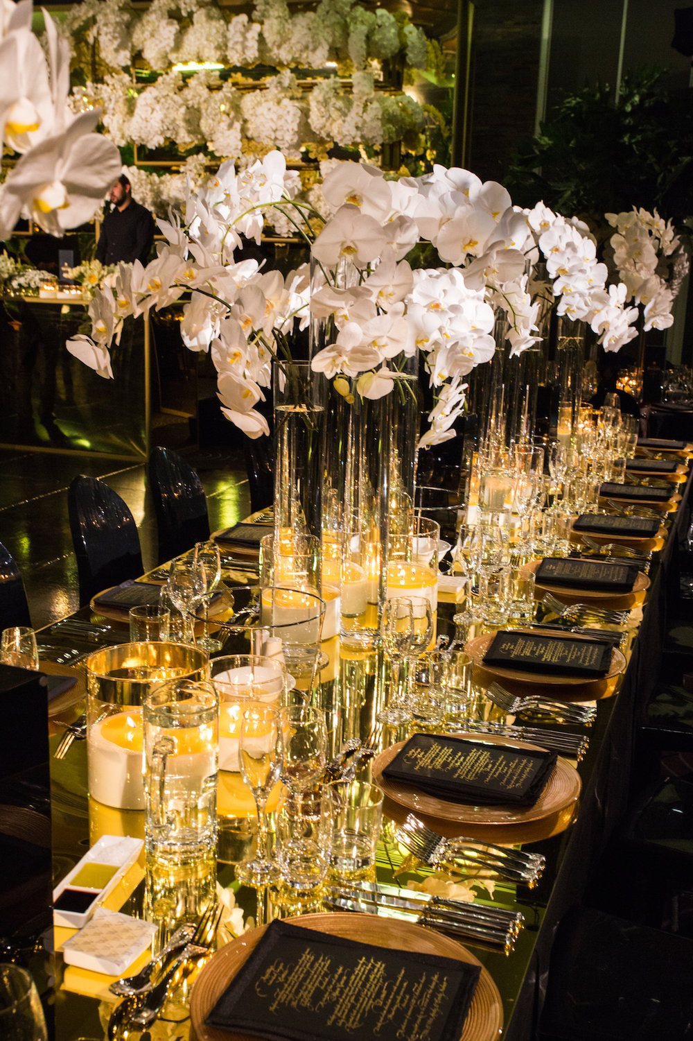 waterview_black_gold_luxury_wedding_mirror_table_orchids_centrepiece.jpg