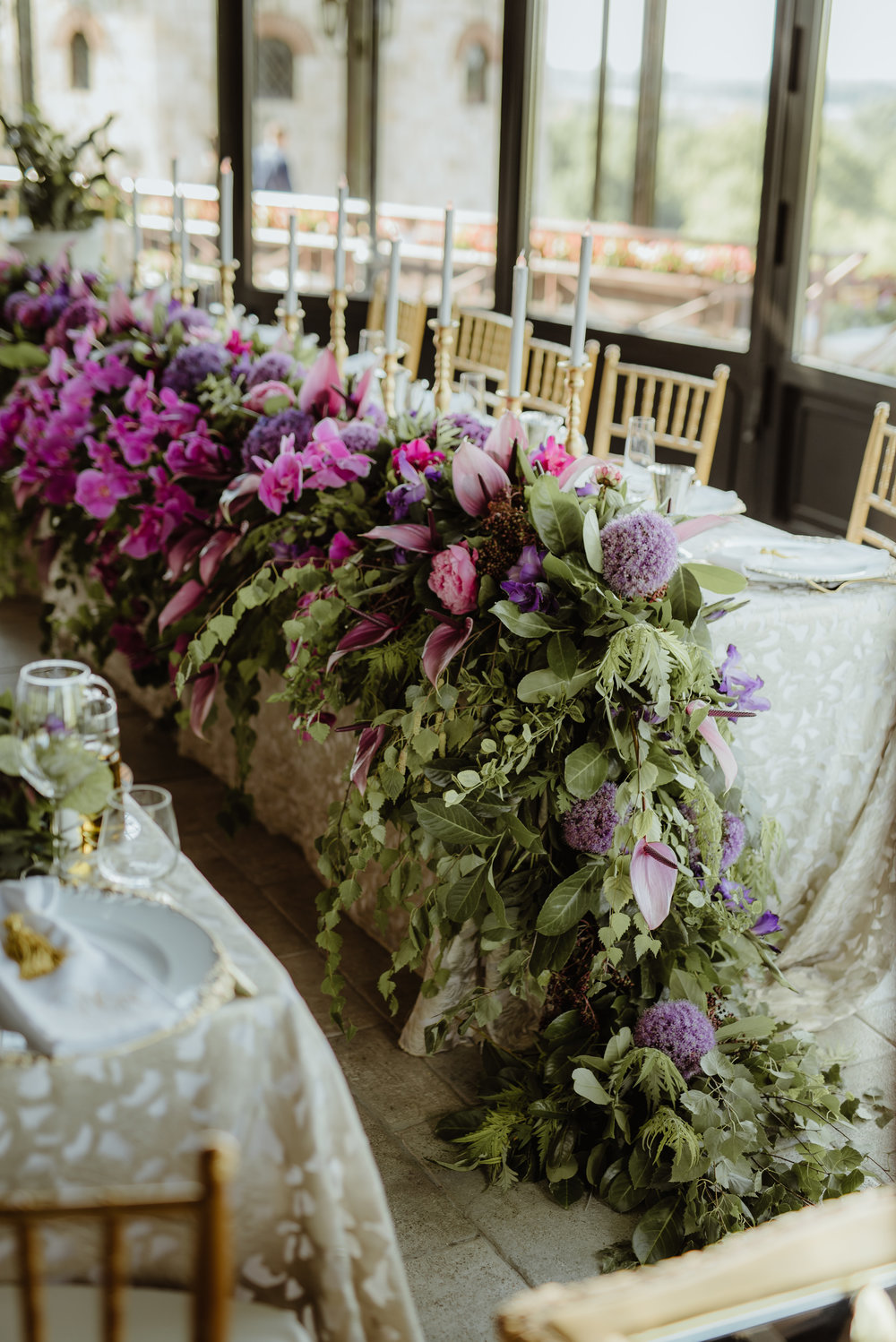 Fresh_flowers_bridal_table_pink_purple_candles_candelabras_luxury_linen.jpg