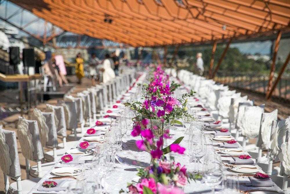 international_womens_day_opera_house_event_pink_purple_flowers_centrepiece.jpg