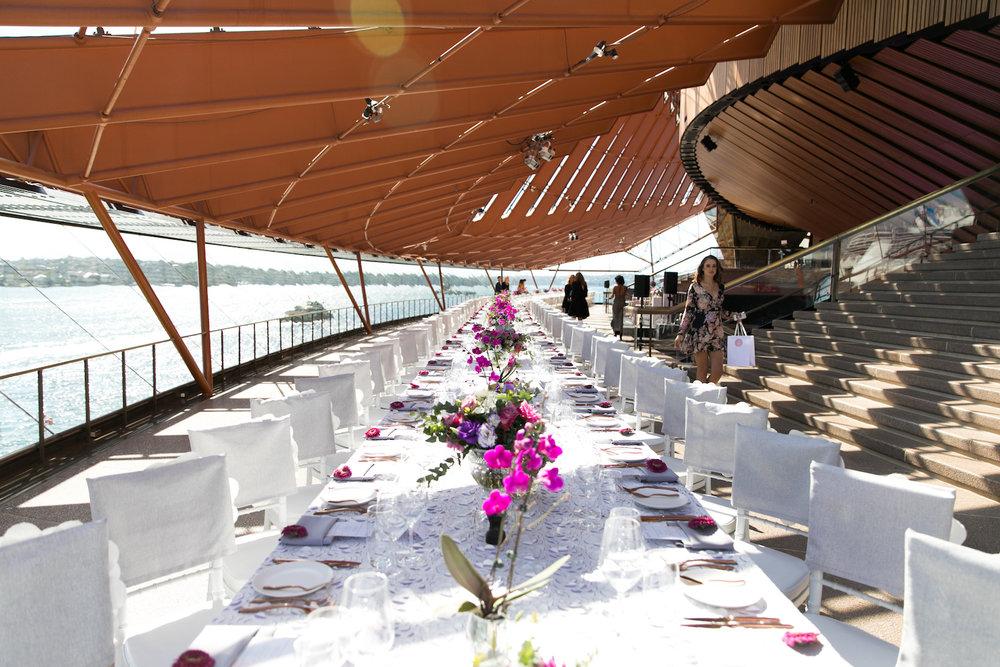 international_womens_day_opera_house_event_pink_purple_flowers_centrepiece_luxury_linen.jpg