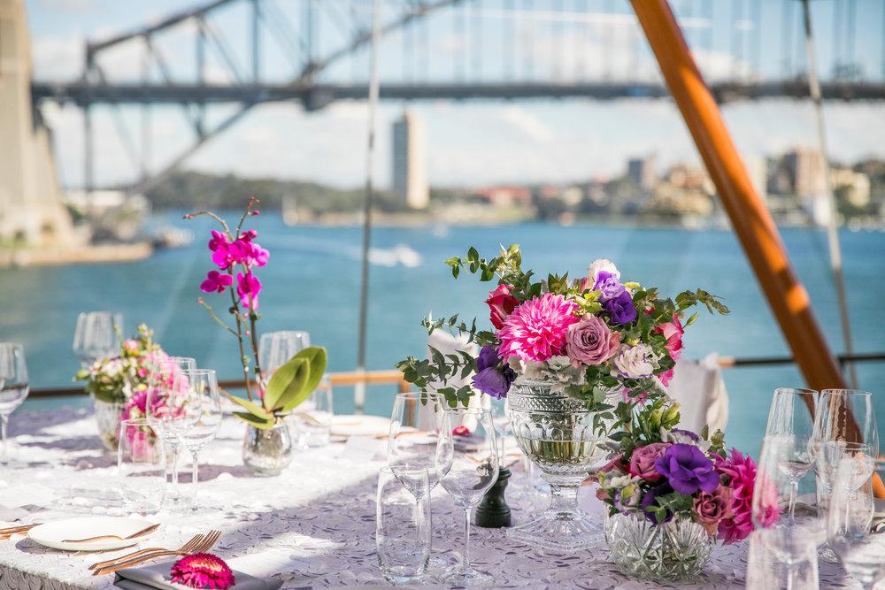 sydney_opera_house_international_womens_day_event_pink_purple_flowers_centrepiece.jpg