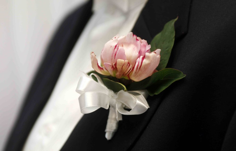 Buttonhole - Peonie with white ribbon tied in a bow.jpg