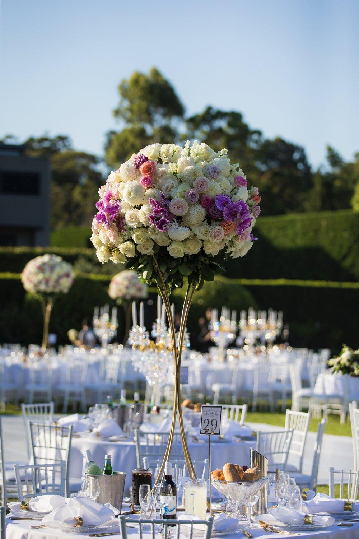 Miramare_gardens_outdoor_sydney_wedding_floral_flowers_centrepiece_gold_stand_tiffany_chairs_white.jpg