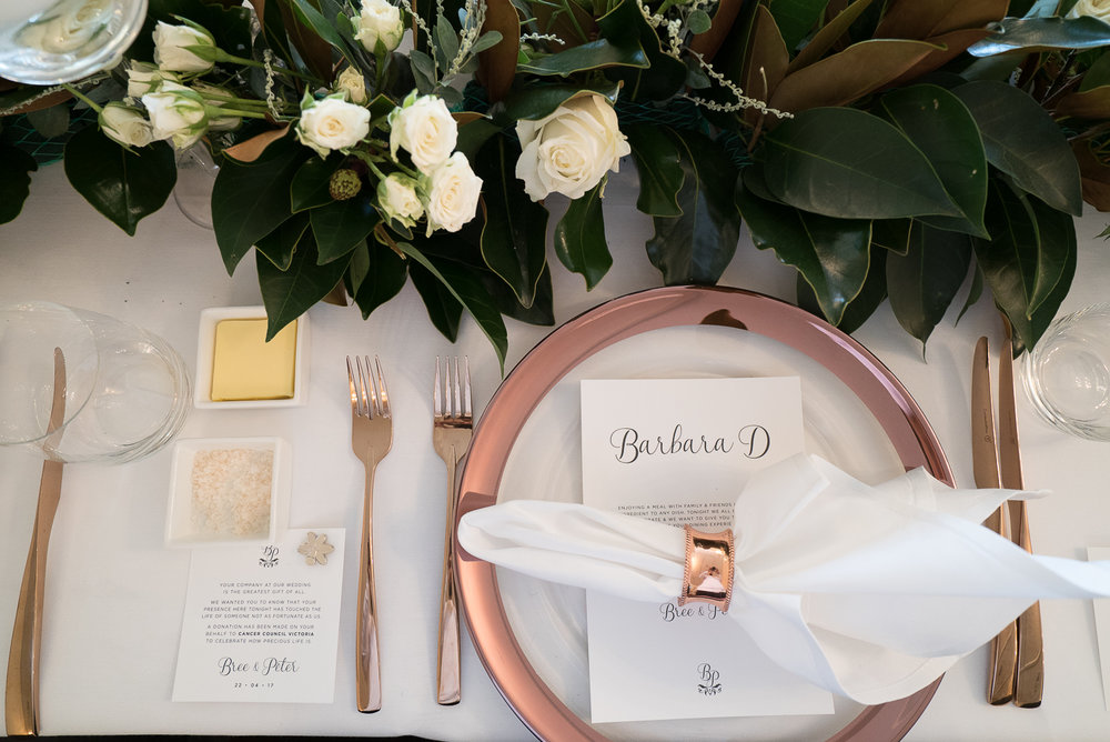 Dunbar House - Greenery and white flowers long and low, rose gold cutlery.jpg