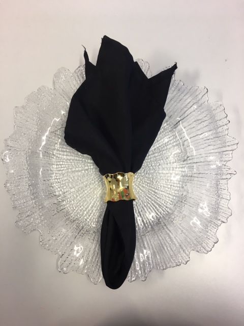 Black napkin with gold napkin ring .jpg