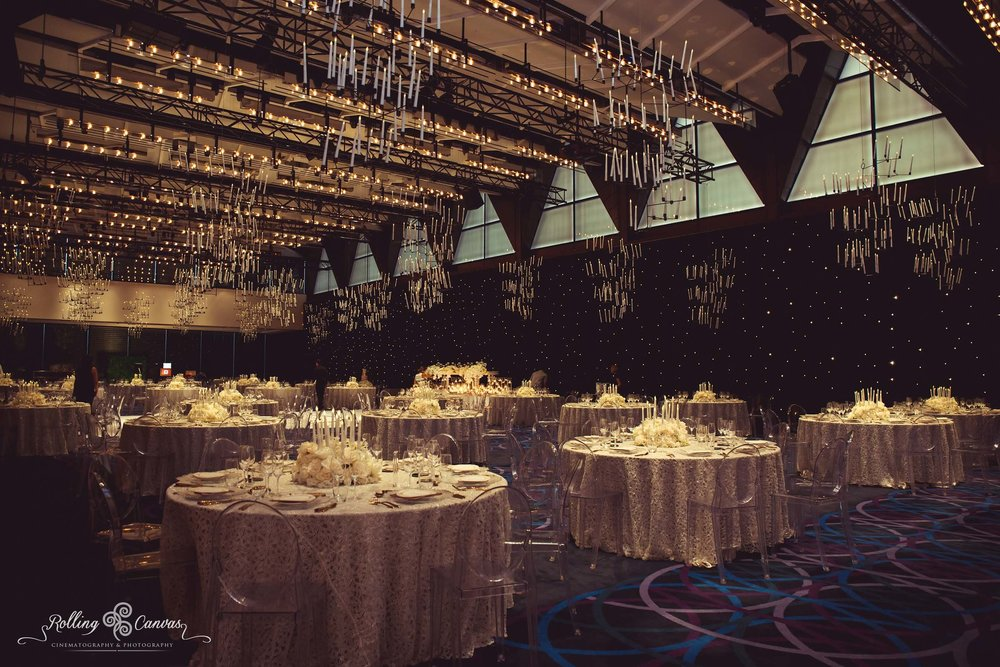 Wedding_Photography_Sydney_Rolling_Canvas_Presentation_black_white_elegant_reception_chandeliers_fairylights_white_dancefloor_luxury_linen_decor_Hyatt_Regency_Sydney-57232.jpg