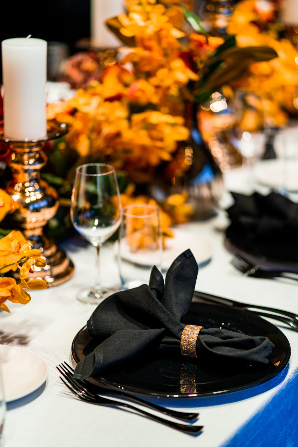 corporate_event_design_events_by_nadia_fresh_flowers_orange_inlighten_photography_black_charger_plate_cutlery_candle_stick_gold_napkin_ring.jpg